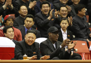 Photo - North Korean leader Kim Jong-un and former N.B.A. star Dennis Rodman watch an exhibition basketball game in Pyongyang. Jason Mojica/VICE Media, via Associated Press