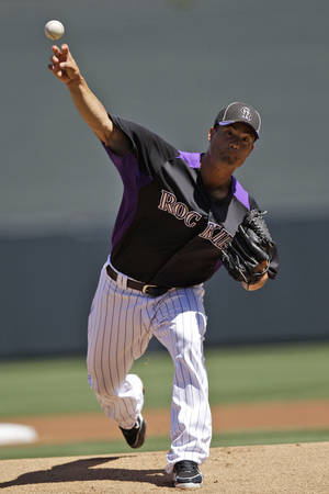 Photo -   Colorado Rockies starting pitcher Jeremy Guthrie throws to the Cleveland Indians during the first inning of a spring training baseball game on Sunday, April 1, 2012, in Scottsdale, Ariz. (AP Photo/Marcio Jose Sanchez)