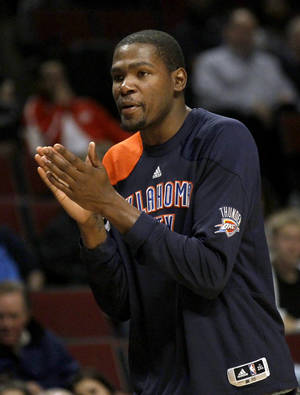 Photo -   Oklahoma City Thunder forward Kevin Durant encourages his team from the bench during the second half of an NBA preseason basketball game against the Chicago Bulls, Tuesday, Oct. 23, 2012, in Chicago. The Bulls won 94-89. (AP Photo/Charles Rex Arbogast)