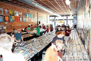Photo - PHOTO SUBMITTED BY WILL MUIR. Customers check out records at Guestroom Records Aug. 23 in Norman. ORG XMIT: KODCJ
