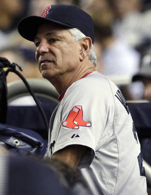 Photo -   Boston Red Sox manager Bobby Valentine watches his team play the New York Yankees during the fourth inning of a baseball game, Wednesday, Oct. 3, 2012, in New York. (AP Photo/Frank Franklin II)