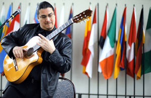 Photo - Edgar Cruz plays during the Global Oklahoma, A festival of cultures, at Rose State College in Midwest City, Saturday, Oct. 6, 2012. Photo by Sarah Phipps, The Oklahoman <strong>SARAH PHIPPS - SARAH PHIPPS</strong>