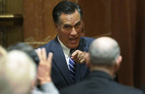 Photo -   Republican presidential candidate and former Massachusetts Gov. Mitt Romney acknowledges donors after he spoke at a campaign fundraising event in Del Mar, Calif., Saturday, Sept. 22, 2012. (AP Photo/Charles Dharapak)