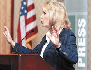 Photo - Gov. Mary Fallin speaks Friday at the Oklahoma Press Association Convention in Midwest City.  Photo by Steve Sisney, The Oklahoman