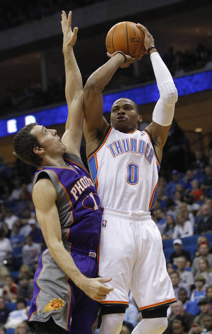 Photo -   Oklahoma City Thunder guard Russell Westbrook (0) shoots in front of Phoenix Suns guard Goran Dragic (1) during the first quarter of an NBA preseason basketball game in Tulsa, Okla., Friday, Oct. 19, 2012. (AP Photo/Sue Ogrocki)