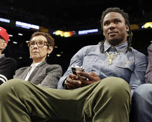 Photo - Former Tennessee Titans running back Chris Johnson watches the second half of an NBA basketball game between the New York Knicks and the Brooklyn Nets Tuesday, April 15, 2014, in New York. The The Knicks won 109-98. (AP Photo/Frank Franklin II)