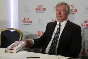 Photo - Former Manchester United manager Sir Alex Ferguson poses with his book 'My Autobiography' during a press conference in central London, Tuesday, Oct. 22, 2013. (AP Photo/Sang Tan)