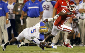 photo - Oklahoma's Kameel Jackson (18) gets past Tulsa's Reid Singleton (5) during the college football game between the University of Oklahoma Sooners (OU) and the Tulsa University Hurricanes (TU) at the Gaylord Family-Oklahoma Memorial Stadium on Saturday, Sept. 3, 2011, in Norman, Okla.  Photo by Chris Landsberger, The Oklahoman ORG XMIT: KOD