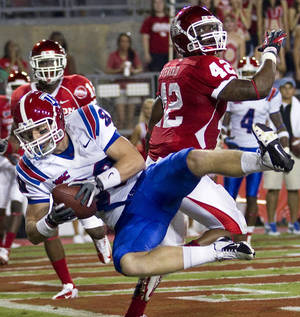 Photo -   Louisiana Tech wide receiver Jon Greenwalt (80) beats Houston linebacker Phillip Steward (42) for a 6-yard touchdown reception during the second quarter of an NCAA college football game at Robertson Stadium on Saturday, Sept. 8, 2012, in Houston. (AP Photo/Houston Chronicle, Brett Coomer)