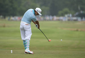 Photo - Rickie Fowler hits his tee shot on the 12th hole during the first round of the U.S. Open golf tournament in Pinehurst, N.C., Thursday, June 12, 2014. (AP Photo/Charlie Riedel)