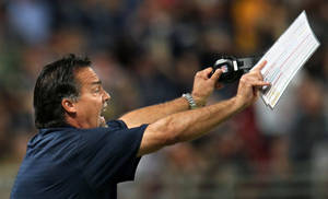 Photo - Rams head coach Jeff Fisher calls to his players during a timeout during an NFL football game, Sunday, Sept. 8, 2013 in St. Louis. (AP Photo/St. Louis Post-Dispatch, Robert Cohen)  EDWARDSVILLE INTELLIGENCER OUT; THE ALTON TELEGRAPH OUT