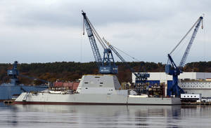 Photo - FILE - In this Oct. 31, 2013 file photo, the Navy's stealthy Zumwalt destroyer is anchored at Bath Iron Works in Bath, Maine. Shipbuilders plan to bring military-grade jet fuel aboard the Navy's biggest destroyer in July 2014, in preparation for lighting off some of the world's largest marine turbines for the first time. (AP Photo/Robert F. Bukaty, File)