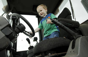 "Photo - Jackson Pruitt steers a Cleveland County loader at last year's ""Touch a Truck"" event."