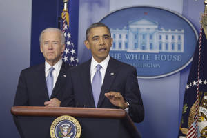 photo - President Barack Obama and Vice President Joe Biden makes a statement regarding the passage of the fiscal cliff bill in the Brady Press Briefing Room at the White House in Washington, Tuesday, Jan. 1, 2013. (AP Photo/Charles Dharapak)