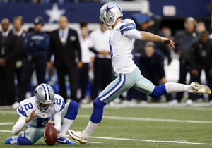 photo -   Dallas Cowboys punter Brian Moorman (2) holds as kicker Dan Bailey, right, prepares to make a winning field goal in overtime of an NFL football game against the Cleveland Browns, Sunday, Nov. 18, 2012, in Arlington, Texas. The Cowboys won 23-20. (AP Photo/Sharon Ellman)