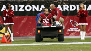 Photo - Arizona Cardinals free safety Tyrann Mathieu (32) is carted off the field after being injured during the second half of an NFL football game against the St. Louis Rams, Sunday, Dec. 8, 2013, in Glendale, Ariz. (AP Photo/Ross D. Franklin)