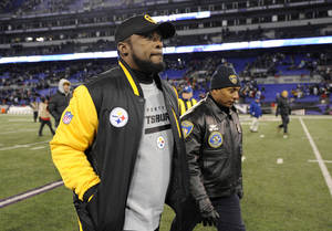 Photo - Pittsburgh Steelers coach Mike Tomlin walks off the field after an NFL football game against the Baltimore Ravens, Thursday, Nov. 28, 2013, in Baltimore. Baltimore won 22-20. (AP Photo/Nick Wass)