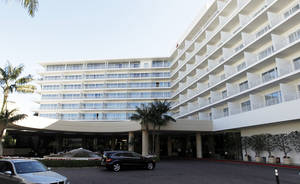 Photo -   This Feb. 17, 2012 photo shows a general view of The Beverly Hilton Hotel in Beverly Hills, Calif. Police say two people have been found dead in what investigators believe was a murder-suicide in a room shooting at the Beverly Hilton, just hours before the Daytime Emmy Awards are being held at the posh hotel. (AP Photo/Matt Sayles)