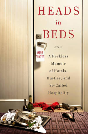 "photo -   This book cover image released by Doubleday shows ""Heads in Beds: A Reckless Memoir of Hotels, Hustles, and So-Called Hospitality. (AP Photo/Doubleday)"