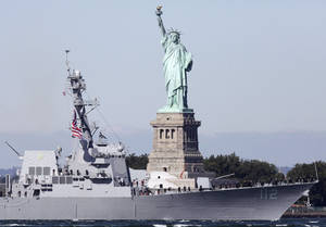 Photo -   The U.S. Navy's newest destroyer, the USS Michael Murphy, powers past the Statue of Liberty as it heads into New York Harbor, Monday, Oct. 1, 2012, in New York. The Arleigh-Burke class destroyer is named for Medal of Honor recipient Michael Murphy, who was killed in Afghanistan in June 2005. (AP Photo/Mark Lennihan)