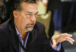 Photo - St. Louis Rams head coach Jeff Fisher talks with reporters during the NFC Head Coaches Breakfast at the NFL football meetings in Orlando, Fla., Wednesday, March 26, 2014. (AP Photo/John Raoux)
