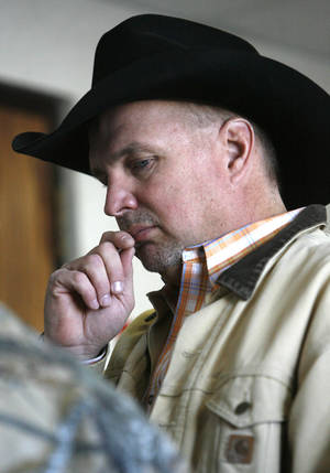 Photo -   Garth Brooks talks with a fan during a break in a civil trial at the Rogers County Courthouse in Claremore, Okla. on Thursday, Jan. 19, 2012. Brooks is suing the Integris Canadian Valley Regional Hospital, saying it wouldn't name a women's center for his late mother, Colleen Brooks, after receiving $500,000 from him. (AP Photo/The Tulsa World, Matt Barnard) TV OUT; TULSA OUT