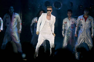 Photo - Canadian singer Justin Bieber performs on stage during his concert in Telenor Arena in Oslo, Tuesday 16 April 2013. (AP Photo/ Lise Aserud, NTB scanpix)