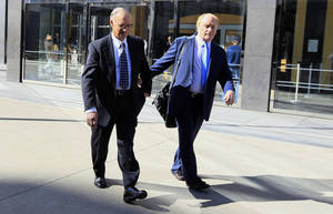 Photo - File - In this March 8, 2012, file photo, Robert Maegerle, left, walks out of a federal courthouse with attorney Jerome Froelich Jr. in San Francisco. Maegerle, a retired DuPont engineer, was convicted of economic espionage charges along with chemical engineer Walter Liew in March. Liew is facing more than 20 years in prison when he is sentenced Thursday, July 10, 2014, for a rare economic espionage conviction for selling technology for a white pigment to China. (AP Photo/Jeff Chiu, File)