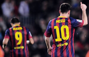 Photo - FC Barcelona's Lionel Messi, from Argentina, gestures after scoring against Athletic Bilbao during a Spanish La Liga soccer match at the Camp Nou stadium in Barcelona, Spain, Sunday April 20, 2014. (AP Photo/Manu Fernandez)