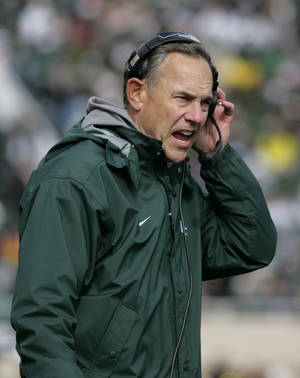 Photo - Michigan State coach Mark Dantonio shouts into his headset on the sidelines during the third quarter of an NCAA college football game against Purdue, Saturday, Oct. 19, 2013, in East Lansing, Mich. Michigan State won 14-0. (AP Photo/Al Goldis)