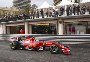 Photo - Ferrari driver Fernando Alonso, of Spain, steers his car during the second free practice session at the Monaco racetrack, in Monaco, Thursday, May 22, 2014. The Monaco Formula One Grand Prix will be held on Sunday. (AP Photo/Antonio Calanni)