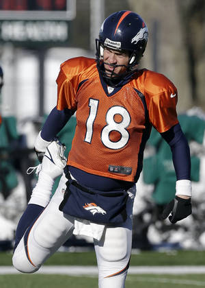 Photo - Denver Broncos quarterback Peyton Manning (18) stretches during practice Wednesday, Jan. 29, 2014, in Florham Park, N.J. The Broncos are scheduled to play the Seattle Seahawks in the NFL Super Bowl XLVIII football game Sunday, Feb. 2, in East Rutherford, N.J. (AP Photo/Mark Humphrey)