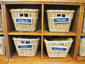 Photo - A place for everything: And everything in its place. Even kids can learn to get and stay organized when you have a system. These baskets have chalkboard labels that you can erase as contents change. Photo courtesy of Mark Brunetz. <strong></strong>