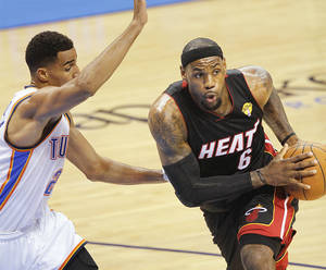 photo - Miami's LeBron James drives past the Thunder's Thabo Sefolosha during Game 2 of the NBA Finals.  Photo by Chris Landsberger, The Oklahoman