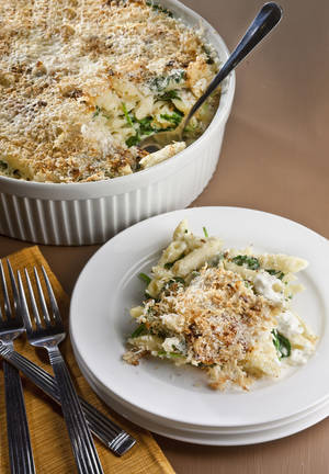"Photo - A good macaroni and cheese takes time. Leaf through the new cookbook, ""Home at 7, Dinner at 8,"" (Kyle, $19.95), by Sophie Wright, for adaptable quick tips. (Bill Hogan/Chicago Tribune/MCT)"