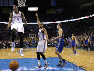 Photo - Serge Ibaka (9) recorded his seventh double-double of the season in the Thunder's 113-112 overtime win against the Golden State Warriors on Friday. Sarah Phipps, The Oklahoman