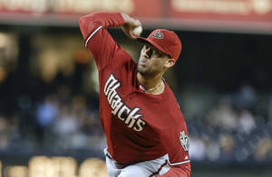 Photo - Arizona Diamondbacks starter Randall Delgado throws against the San Diego Padres in the first inning of a baseball game Wednesday, Sept. 25, 2013, in San Diego. (AP Photo/Lenny Ignelzi)