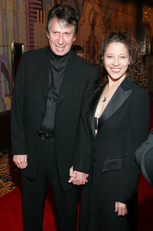 Photo - FILE - In this Thursday, Feb. 24, 2005 file photo, comedian David Brenner and Olympic ice skater Tai Babilonia walk the red carpet during the opening night of Barry Manilow's new Las Vegas show at the Las Vegas Hilton. On Saturday, March 15, 2014, publicist Jeff Abraham announced Brenner had died at the age of 78. (AP Photo/Eric Jamison)