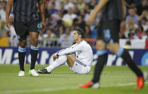Photo -   Real Madrid's Cristiano Ronaldo from Portugal reacts during a Group D Champions League soccer match against Manchester City at the Santiago Bernabeu stadium in Madrid Tuesday Sept. 18, 2012. (AP Photo/Paul White)