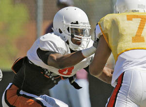 Photo - OSU's Justin Gilbert (4) works against Shamiel Gary (7) as part of a drill during spring football practice for the Oklahoma State Cowboys in Stillwater, Okla., Friday, April 1, 2011. Photo by Nate Billings, The Oklahoman