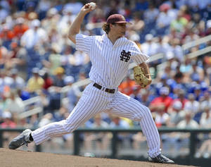 Photo - Mississippi State starting Kendall Graveman delivers against Oregon State in the first inning of an NCAA College World Series baseball game in Omaha, Neb., Friday, June 21, 2013. (AP Photo/Eric Francis)