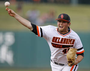 Photo -                    OSU's Jon Perrin pitches Thursday against OU at Chickasaw Bricktown Ballpark.                     Photo by Bryan Terry, The Oklahoman