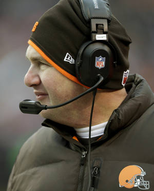 Photo - Cleveland Browns head coach Rob Chudzinski looks on from the sidelines in the fourth quarter of an NFL football game against the Chicago Bears, Sunday, Dec. 15, 2013, in Cleveland. (AP Photo/Tony Dejak)