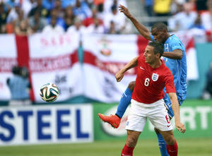 Photo - England's Phil Jagielka (6) looks for the ball after Honduras' Jerry Bengtson (11) kicks the ball away during the first half of a friendly soccer match in Miami Gardens, Fla., Saturday, June 7, 2014. ( AP Photo/J Pat Carter)