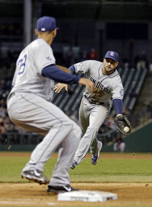 Photo - San Diego Padres first baseman Yonder Alonso flips the ball from his glove to pitcher Tyson Ross to get Cleveland Indians' Carlos Santana on a groundout in the third inning of the MLB baseball game Tuesday, April 8, 2014, in Cleveland. (AP Photo/Mark Duncan)