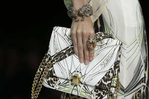 Photo -   A model wears a creation part of the Roberto Cavalli women's Spring-Summer 2013 collection that was presented in Milan, Italy, Monday, Sept. 24, 2012. (AP Photo/Luca Bruno)