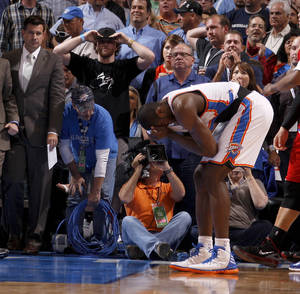 Photo - Oklahoma City's Serge Ibaka (9) reacts after Oklahoma City's 100-98 loss in an NBA basketball game between the Oklahoma City Thunder and the Los Angeles Clippers at Chesapeake Energy Arena in Oklahoma City, Wednesday, April 11, 2012. Photo by Bryan Terry, The Oklahoman
