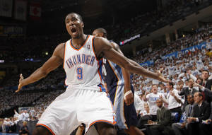 photo - Oklahoma City's Serge Ibaka (9) reacts to a call during game five of the Western Conference semifinals between the Memphis Grizzlies and the Oklahoma City Thunder in the NBA basketball playoffs at Oklahoma City Arena in Oklahoma City, Wednesday, May 11, 2011. Photo by Sarah Phipps, The Oklahoman  ORG XMIT: KOD