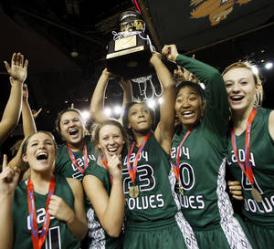 photo - Courtney Walker (23) raises the gold ball championship trophy as the Edmond Santa Fe Lady Wolves celebrate after the Class 6A girls high school basketball state tournament championship game between Edmond Santa Fe and Edmond Memorial at the Mabee Center in Tulsa, Okla., Saturday, March 10, 2012. Santa Fe won, 44-41. Photo by Nate Billings, The Oklahoman