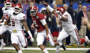 Photo - Alabama's Amari Cooper (9) runs past Oklahoma's Charles Tapper (91) during the NCAA football BCS Sugar Bowl game between the University of Oklahoma Sooners (OU) and the University of Alabama Crimson Tide (UA) at the Superdome in New Orleans, La., Thursday, Jan. 2, 2014.  .Photo by Chris Landsberger, The Oklahoman